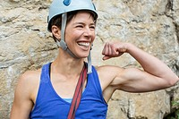Female rock climber showing off muscles
