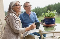 Senior couple enjoying coffee outdoors