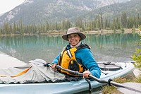 Portrait of pretty, middle_aged woman in kayak.