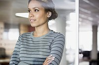Pretty, African American woman in thought at the office (thumbnail)