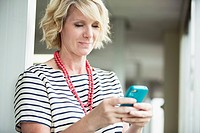 Businesswoman texting on smart phone