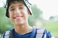 Portrait of smiling, young male baseball catcher (thumbnail)