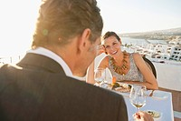 Couple having dinner in outdoor restaurant (thumbnail)