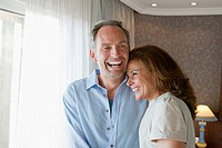 Couple laughing in hotel room