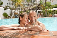 Portrait of couple in swimming pool