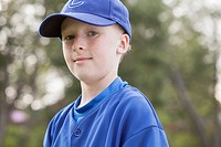 Portrait of serious young baseball player in uniform