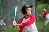 Young male baseball player up to bat