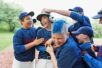 Boys baseball team celebrating after winning game (thumbnail)