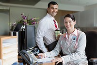 Portrait of medical professionals at office desk