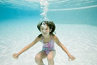 Girl 8_9 diving in swimming pool