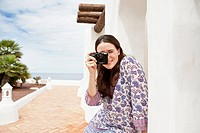 Woman taking pictures during vacations