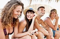 Happy friends on beach