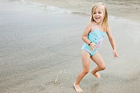 Girl 4_5 running on beach
