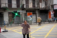 A senior crossing road, Macau