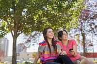 Teenage girls relaxing in outdoor park
