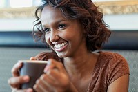 Pretty African American woman enjoying a cup of coffee