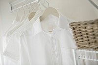 Close_up of clean, white shirts in closet