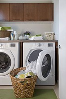 Contemporary laundry room with basket of clean clothes