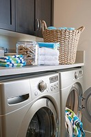 Contemporary laundry room with storage and washer and dryer