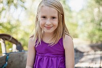 Portrait of cute blond girl in purple shirt