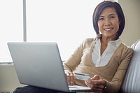 Portrait of Asian businesswoman making online purchase