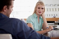 Pretty blond businesswoman in meeting at office
