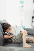 Young boy browsing on pc tablet (thumbnail)