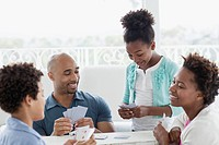African American family having a card night