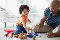 Father and toddler son playing with toys