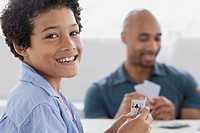 Preteen boy playing cards with his dad