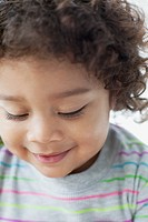 Close_up of curly haired toddler looking down