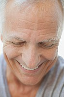 Close_up of senior man laughing and looking down