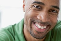 Close_up of African American man smiling.