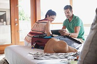 Couple browsing on pc tablet in room (thumbnail)