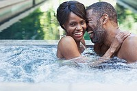 Couple sharing a laugh in hot tub