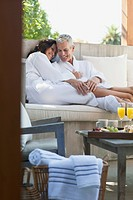 Couple lounging on outdoor patio