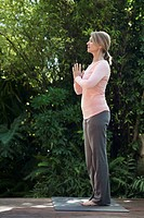 Profile of woman in yoga pose