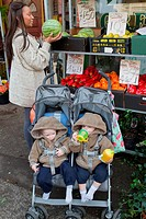Mother with twins in buggy out shopping This photo has extra clearance covering Homelessness, Mental Health Issues, Bullying, Education and Exclusion,...
