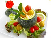 Zucchini stuffed with cheese and salad