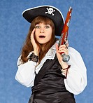Scared woman _ sea pirate on blue background with pistol