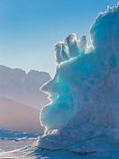 Icebergs, Scoresbysund, Greenland Face in Iceberg drifting in Scoresbysund, Sermersooq Municipality, Greenland