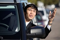 Young Asian businessman in a traffic jam