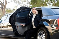 Woman exiting a limousine