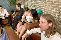 Group of young people sitting together at party