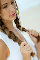 Young woman with plaits