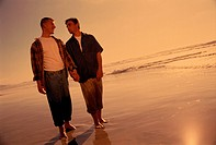 Gay Couple Walking the Beach