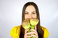 Female model with artichokes in her hands