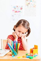 5 year old girl in a classroom.