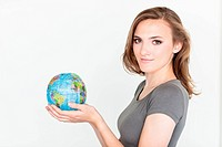 Woman holding a map of the world.