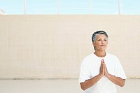 Senior woman in white T_shirt meditating